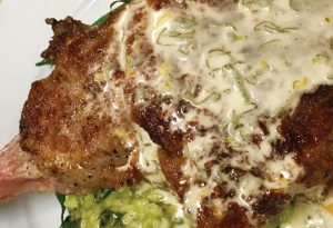 Veal Chop Saltimbocca with Roasted Garlic-Spinach Risotto and Lemon-Sage Butter
