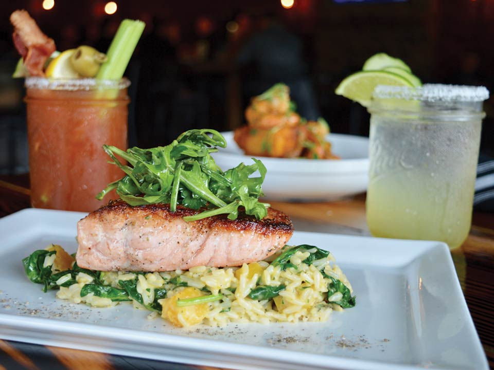 Seared Salmon with Butternut Squash Risotto, Spinach, Herb Salad from RiverTowne Public House in Mount Pleasant, SC