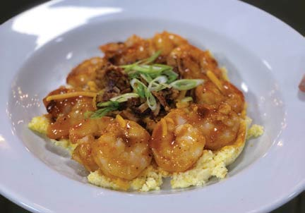 82 Queen's world-famous Barbecue Shrimp 'n' Grits.