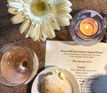 Boone Hall Farms: Flowers and candlelight dot the tables, and soft live music fills the background while diners pore over the drink and dinner options.