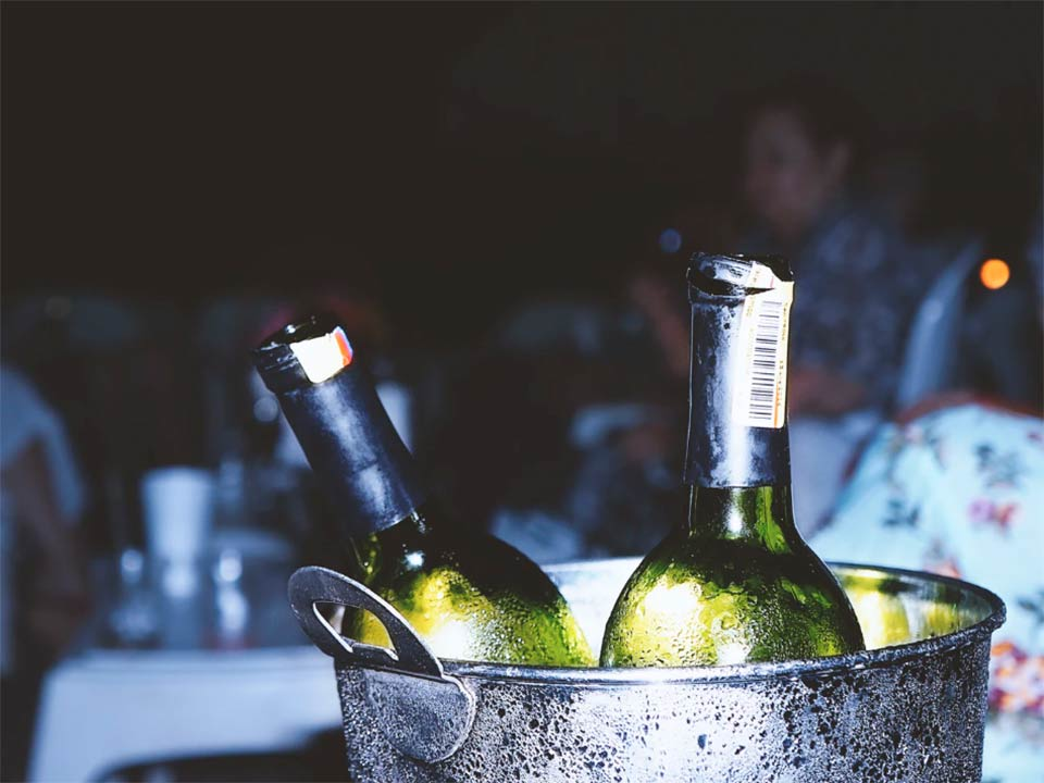 Chilling white wines in a bucket of ice