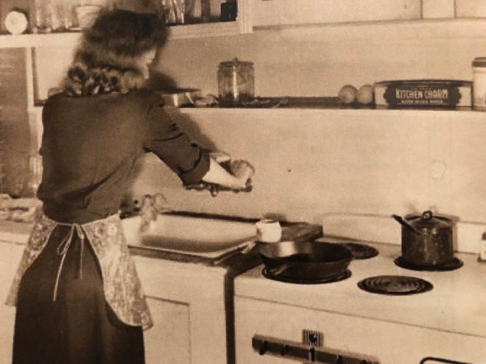 Grandmama cooks in her kitchen on Hasell Street in Charleston in 1946. She still has that cast iron skillet.