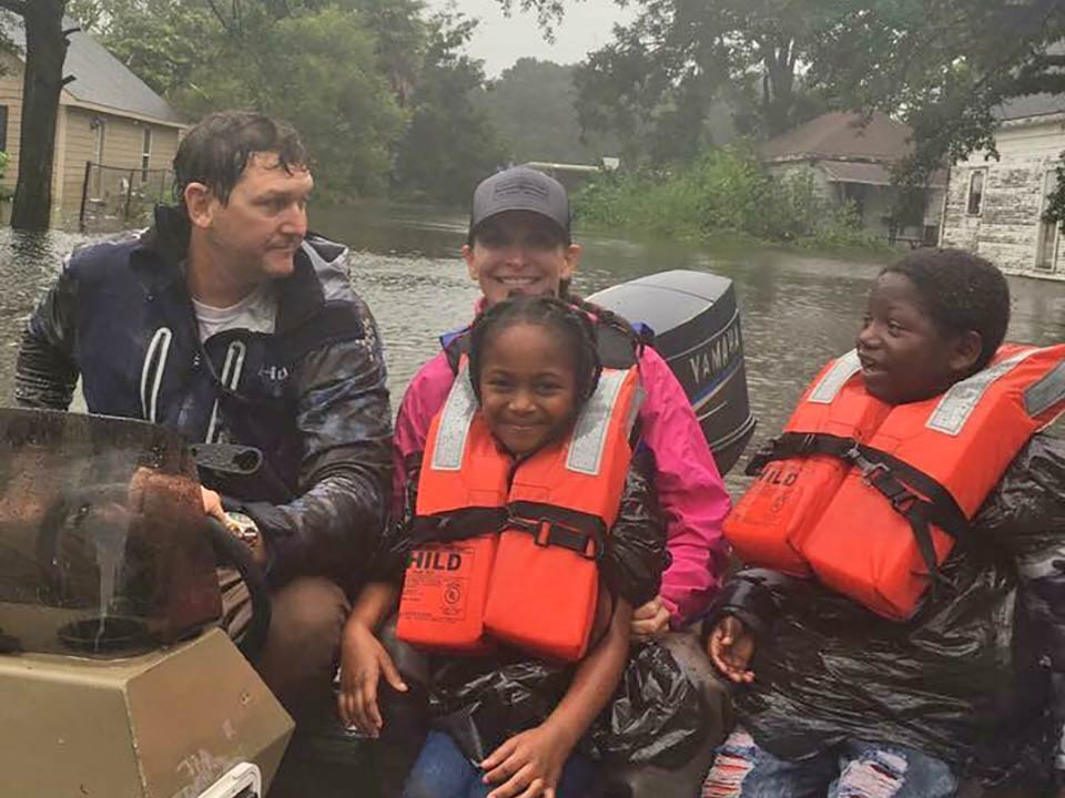Jamie Hough and Sally Myers help flood victims in Beaumont, Texas.