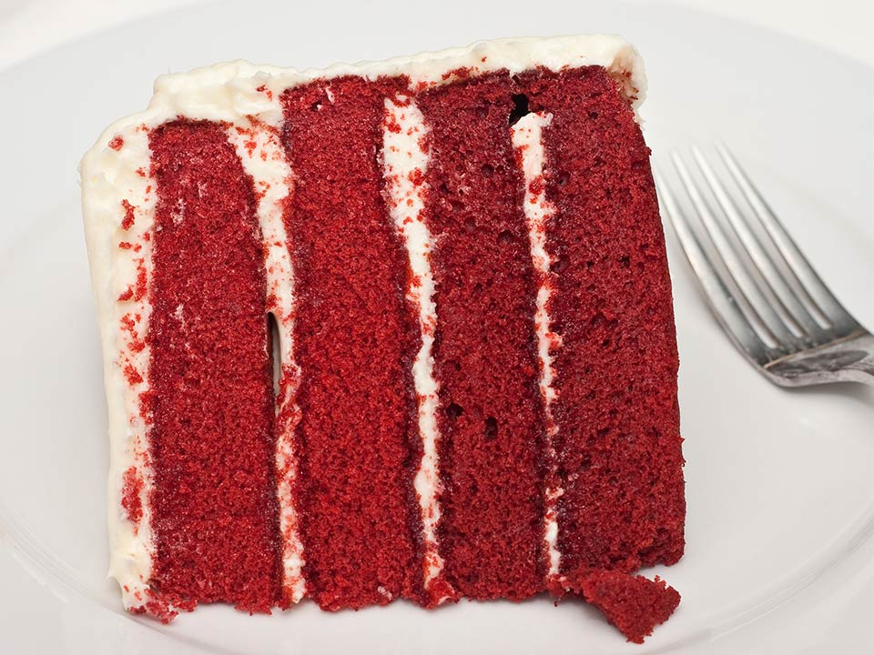 A photograph of scrumptious piece of Red Velvet Cake