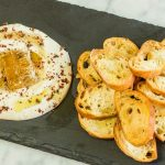 Whipped ricotta dip with house-made ricotta drizzled with local honey and pink peppercorns.