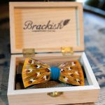 The Sawyers bow tie from Brackish is crafted with pheasant feathers. The design is bright and bold, honoring traditional menswear with its polka dot design. Its center wrap is made with a vibrant blue grosgrain fabric.