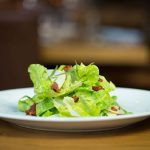 Butter lettuce salad with green goddess, country ham and Asian pear.