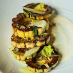 The delicata squash appetizer with sorghum crème fraiche, Mutsu apple and marcona almond.