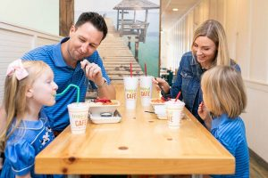 he Bulsiewicz family enjoys time together at Tropical Smoothie Cafe in The Market at Oakland.
