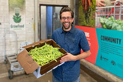 GrowFood Carolina General Manager Anthony Mirisciotta shows off fresh, local produce.